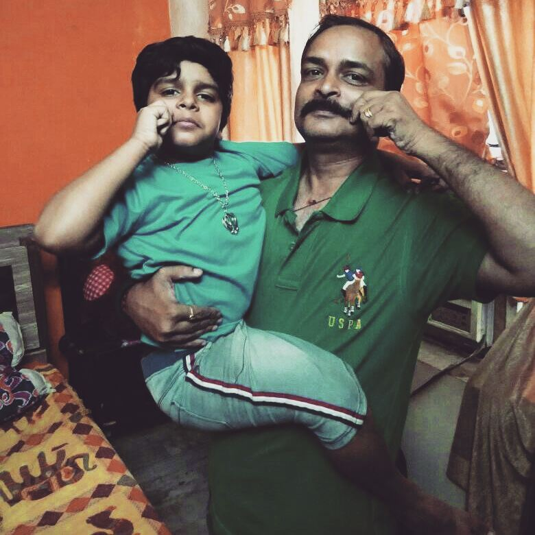 Divyansh with her father