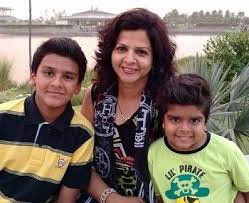 Divyansh with her mother and brother