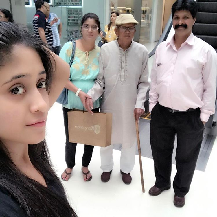 Shivangi with her parents and grandfather