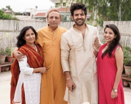 Kartik with his family